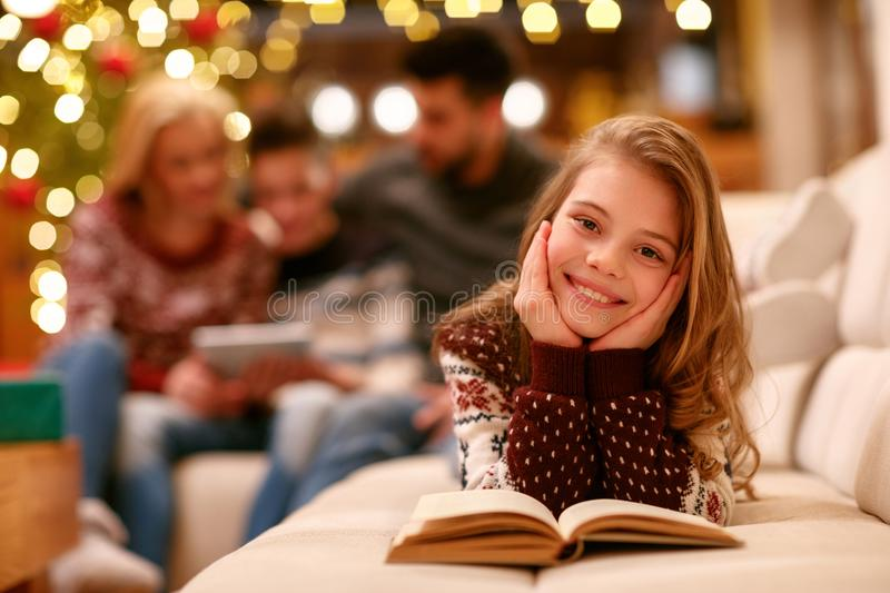 Portrait of cute girl reading book stock photography