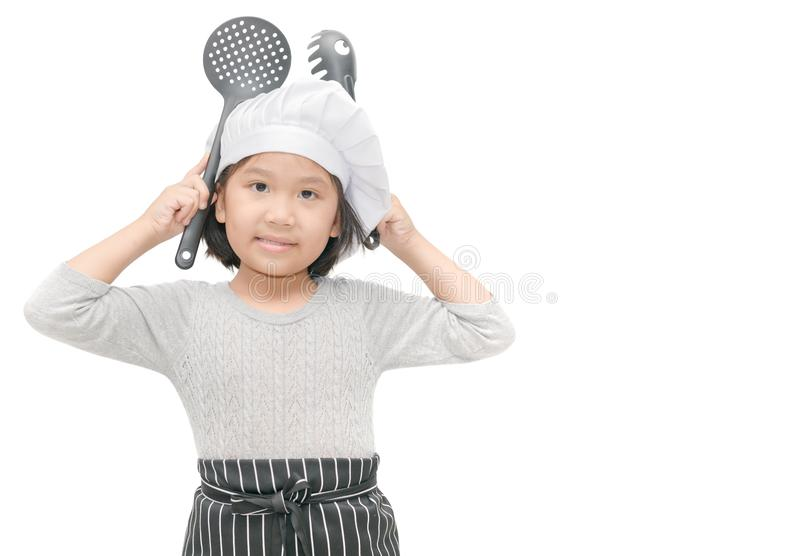 Portrait of cute girl chef with cook hat and apron royalty free stock images