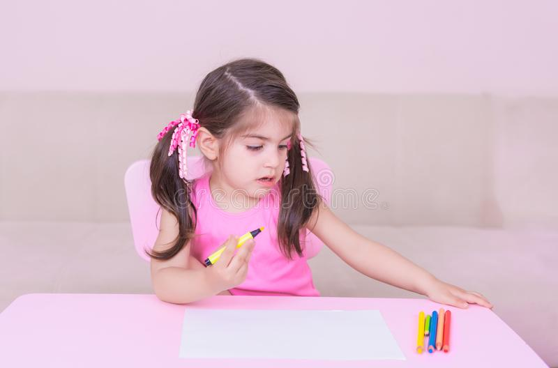 Portrait of Cute girl drawing with colorful pencils stock images