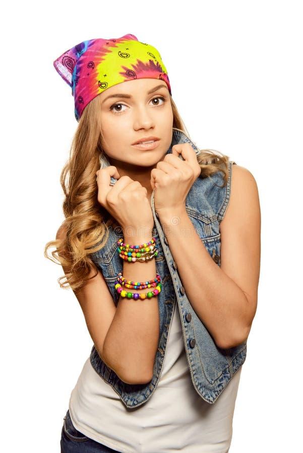 Portrait of cute girl in jeans vest stock photo
