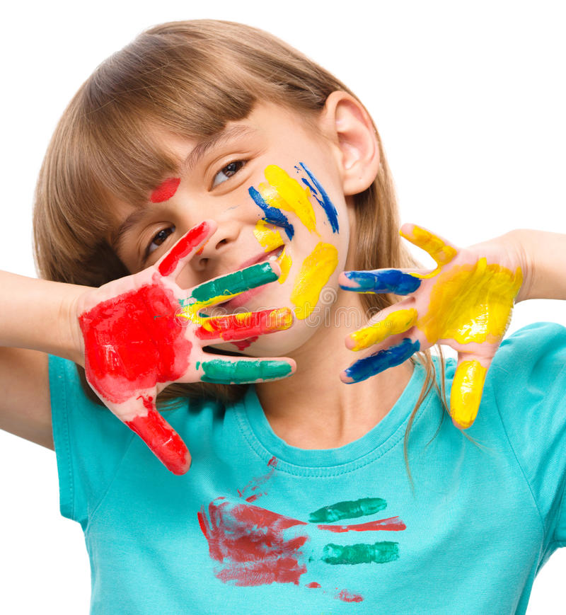 Portrait of a cute girl playing with paints. Portrait of a cute cheerful girl showing her hands painted in bright colors, isolated over white royalty free stock image