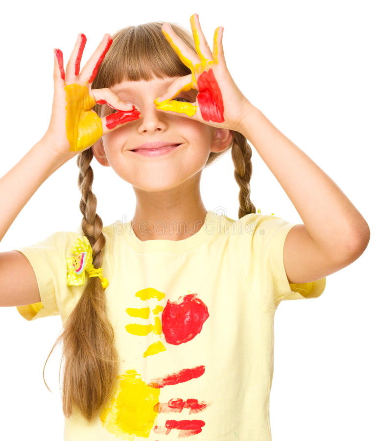 Portrait of a cute girl playing with paints. Portrait of a cute girl showing her hands painted in bright colors, isolated over white royalty free stock images