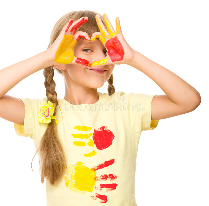 Portrait of a cute girl playing with paints. Portrait of a cute girl showing her hands painted in bright colors, isolated over white stock images