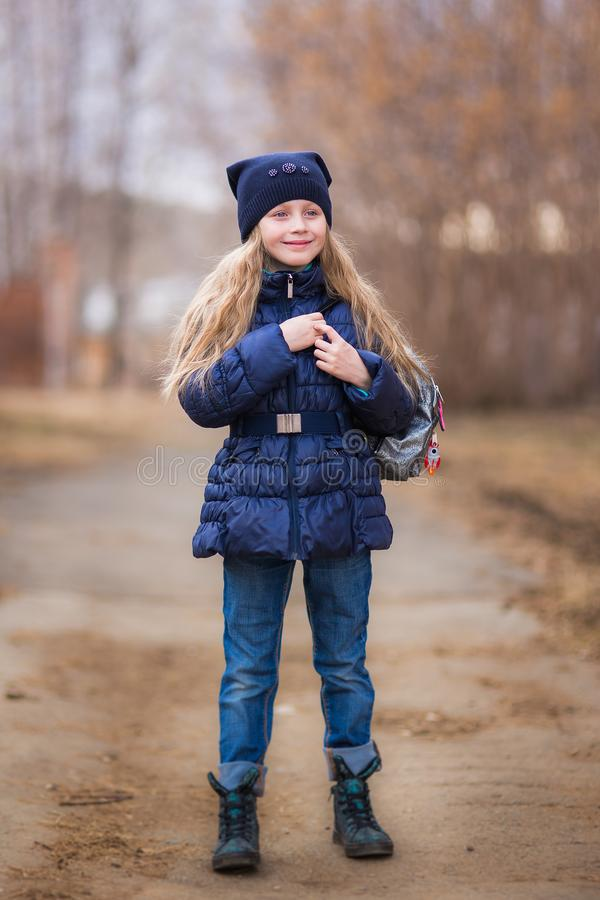 Portrait of a cute girl 7 years old in the park stock photography