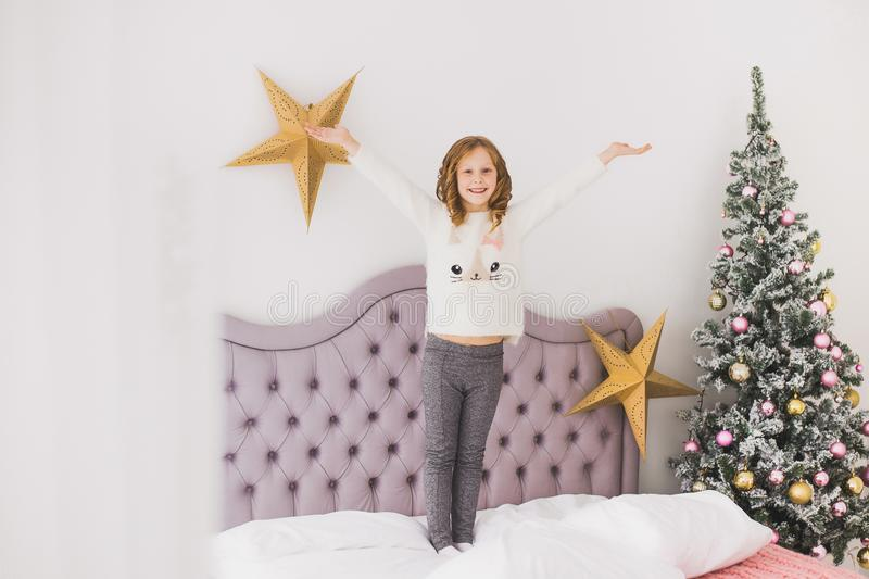Little girl on Christmas morning in home interior stock image