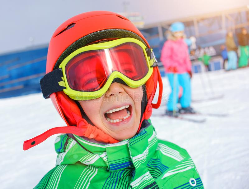 Skier boy in a winter ski resort. royalty free stock images