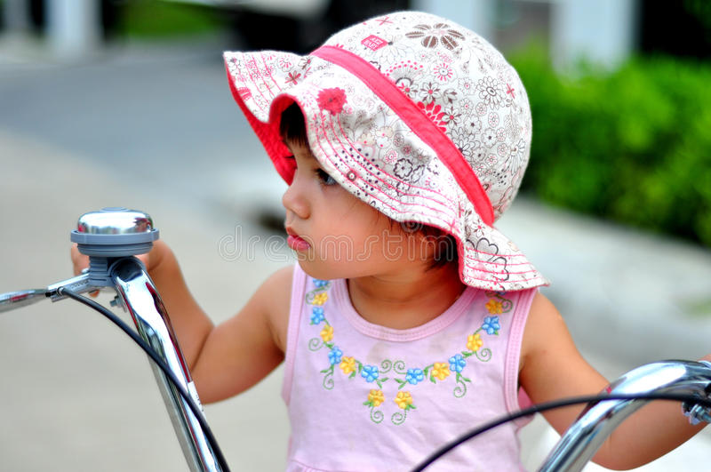 Portrait of a cute kid on bicycle stock image