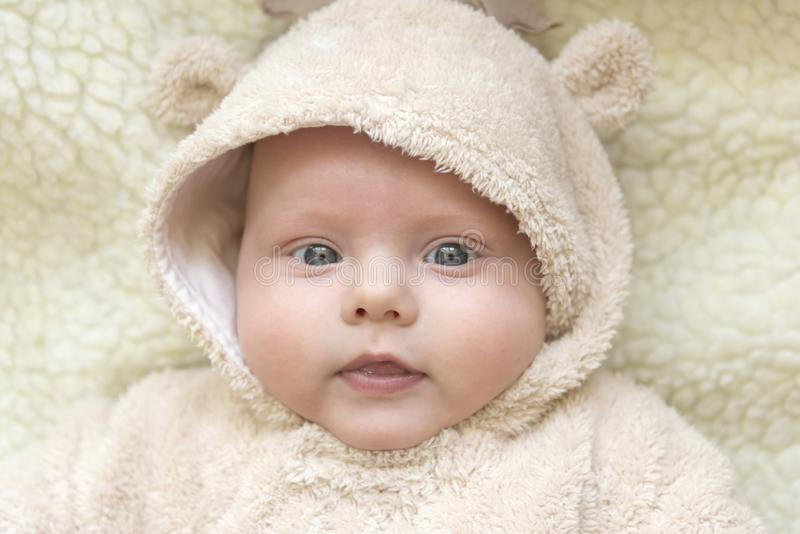 Portrait of a cute kid in a deer suit. Portrait of a cute blue-eyed kid in a deer suit stock images