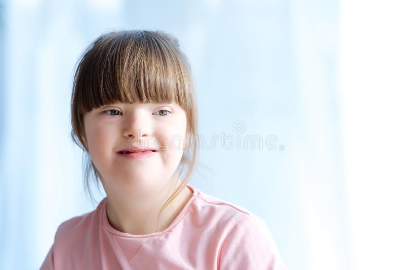 Portrait of cute kid. With down syndrome stock photos