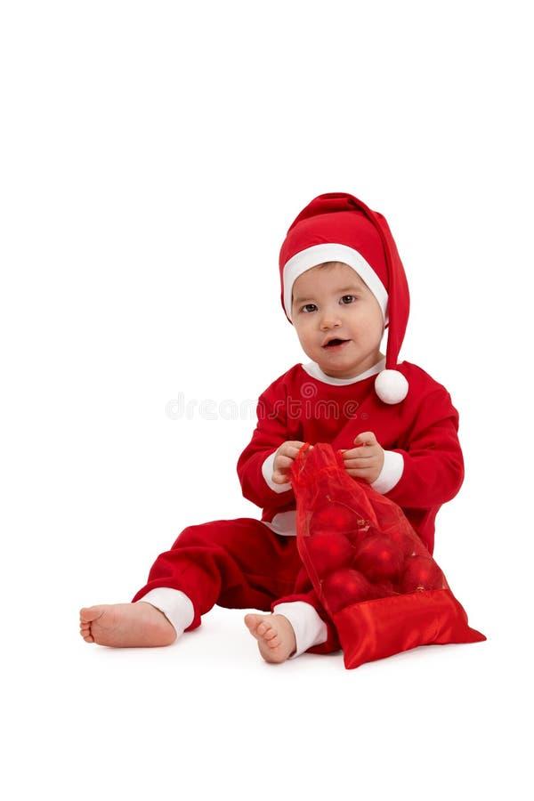 Portrait of cute kid in santa costume stock image