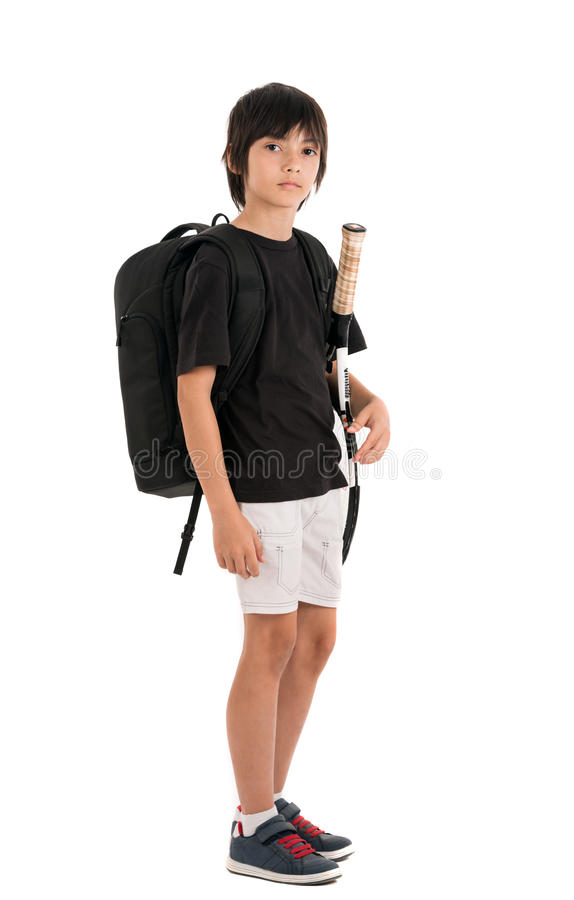 Portrait of a cute kid with tennis racquet isolated on white background royalty free stock photos