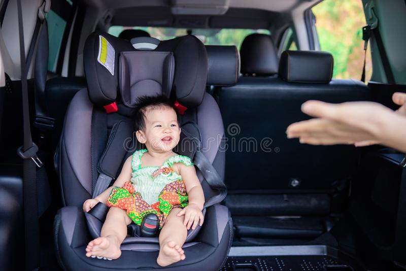 Cute little baby child sitting in car seat. Child transportation safety. Portrait of cute little baby child sitting in car seat. Child transportation safety royalty free stock images