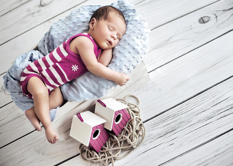 Portrait of a cute little baby having a nap stock photos