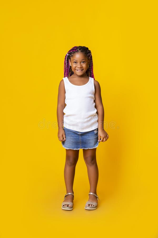 Portrait of cute little black girl with afro braids royalty free stock image