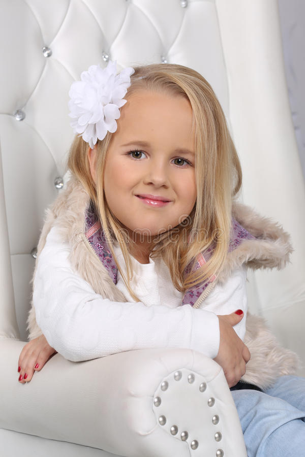 Portrait of a cute little blond girl with long hair royalty free stock image