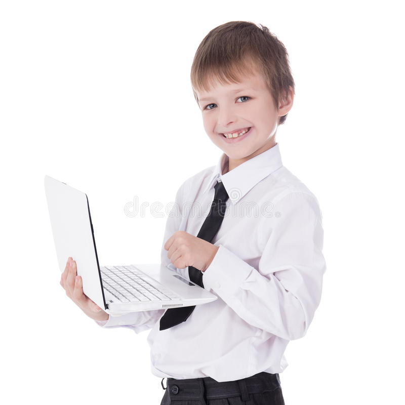 portrait of cute little boy in business suit using laptop isolated on white stock image