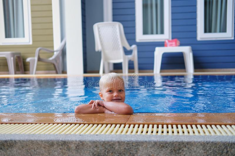 Portrait boy child in swimming pool home summer holiday, outdoors. Portrait of cute little boy with pigment spots on his face in swimming pool home summer royalty free stock photo