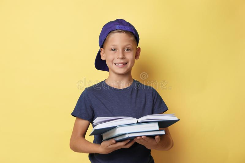 Portrait of cute little boy reading book on background stock photo