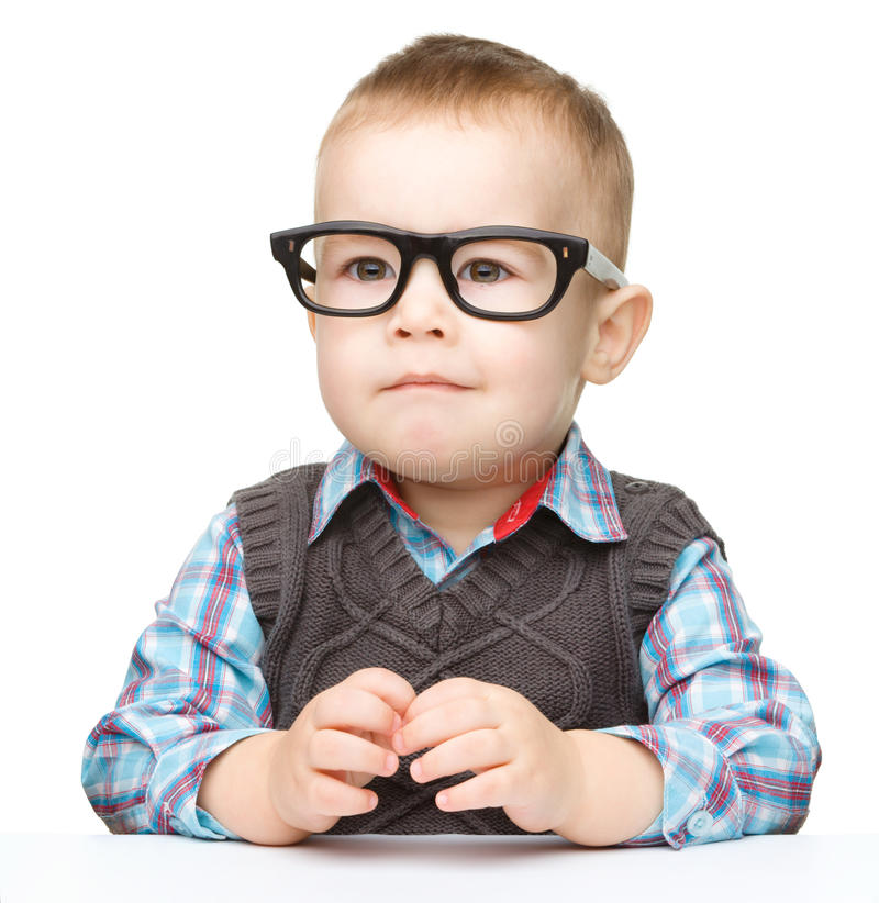 Portrait of a cute little boy wearing glasses royalty free stock photo
