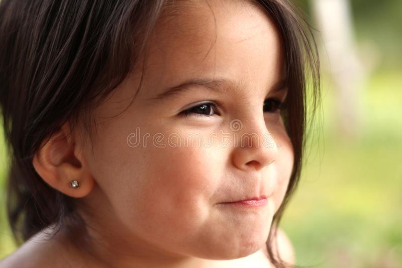 portrait of a cute little cheerful girl in the park outdoors royalty free stock photos