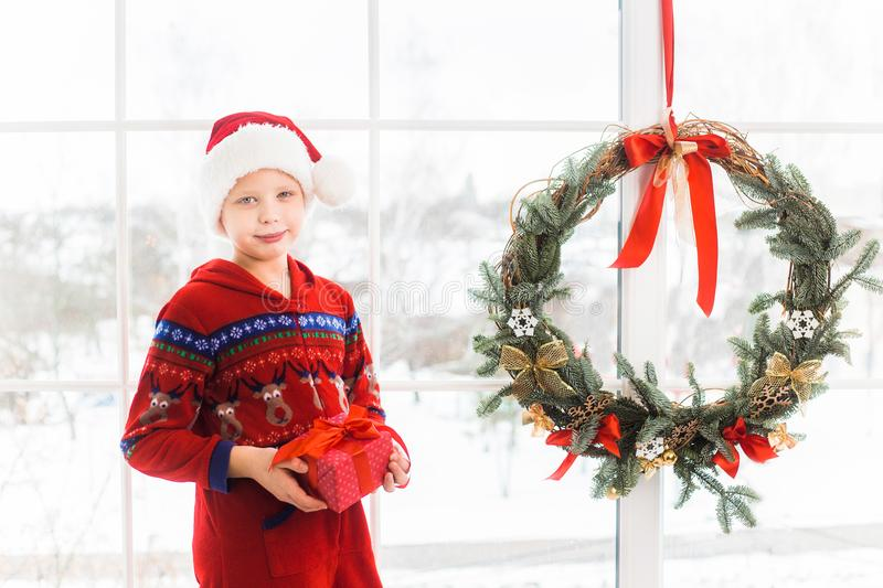 Little child in holiday christmas interior royalty free stock image