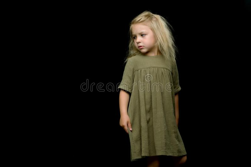 Portrait of a cute little girl on a black background. Happy chil royalty free stock photography