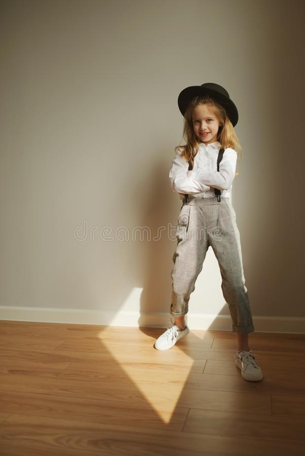 Cute little girl with black hat at home royalty free stock photos