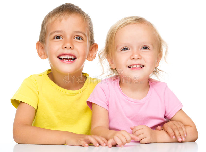 Portrait of a cute little girl and boy. Isolated over white stock images