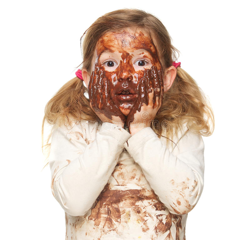 Covered in Chocolate. Portrait of a cute little girl covered in brown chocolate stock photography