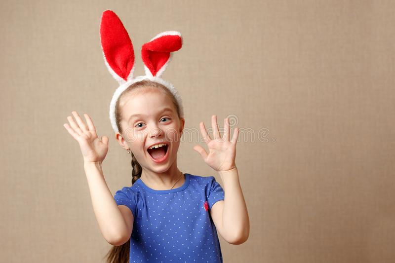 Happy easter. Portrait of a cute little girl dressed in Easter bunny ears royalty free stock photo