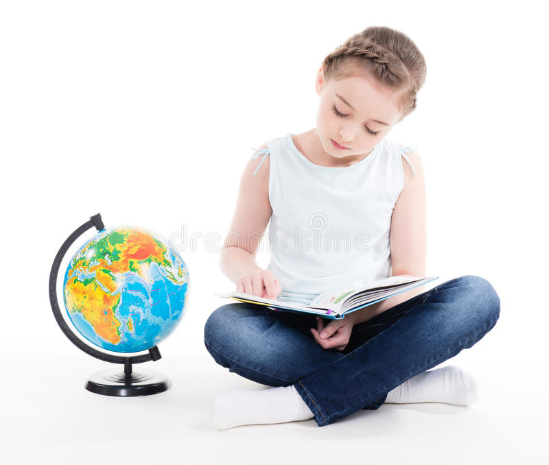 Portrait of a cute little girl with a globe. stock images