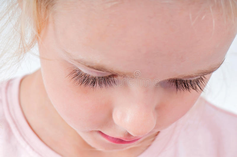 Portrait of cute little girl with long eyelashes stock photos