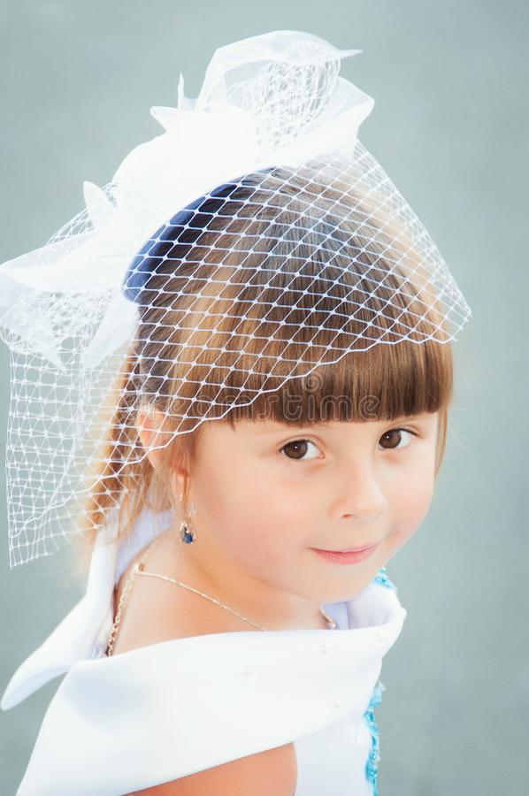 Portrait of a cute little girl in a magnificent white and blue dress royalty free stock photos