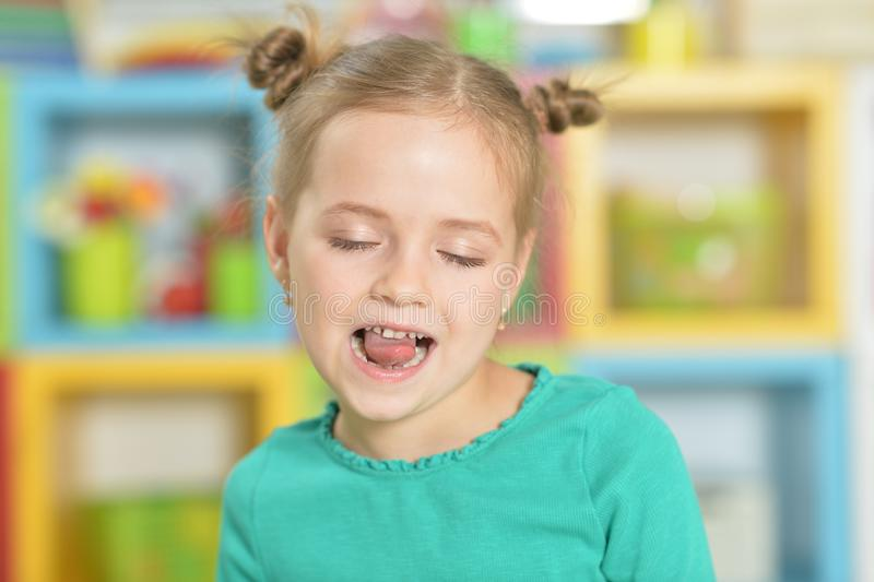 Portrait of little girl making funny faces royalty free stock photography