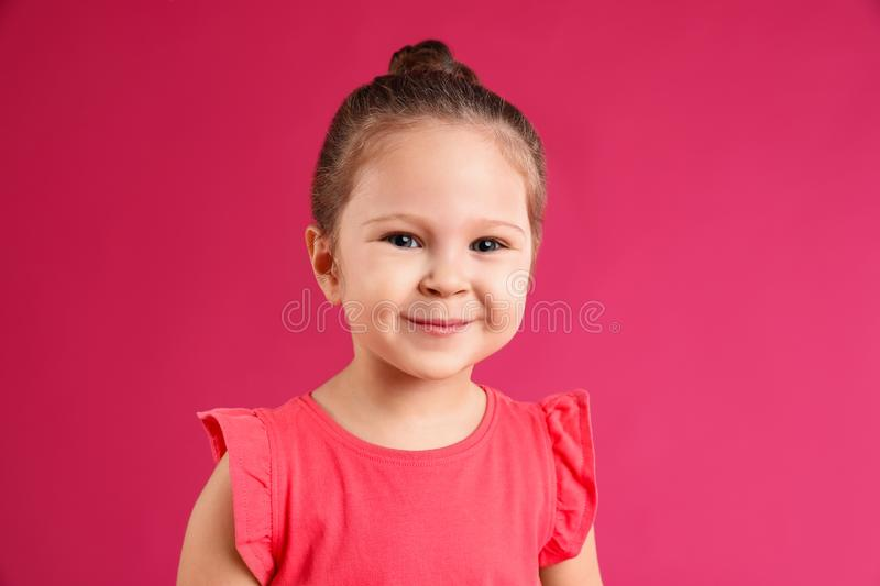 Portrait of cute little girl on background royalty free stock photography