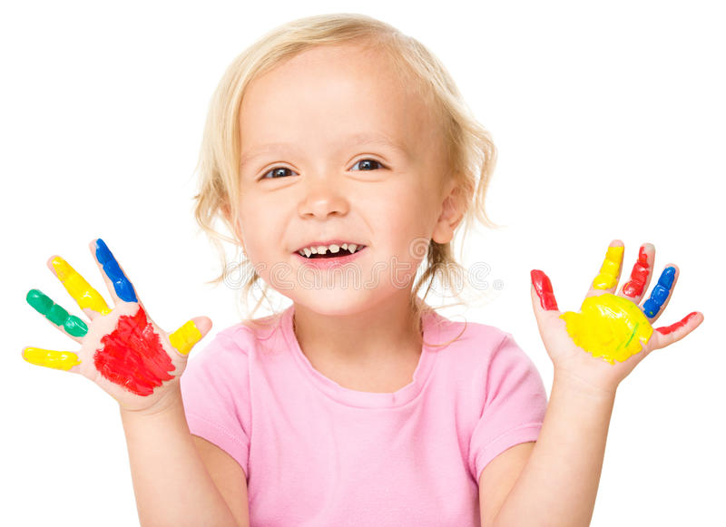 Portrait of a cute little girl playing with paints. Portrait of a cute little girl showing her hands painted in bright colors, isolated over white royalty free stock photos