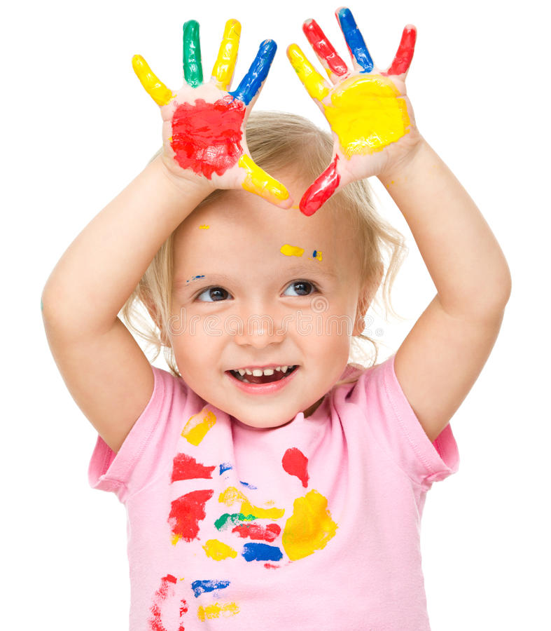 Portrait of a cute little girl playing with paints. Portrait of a cute little girl showing her hands painted in bright colors, isolated over white stock images
