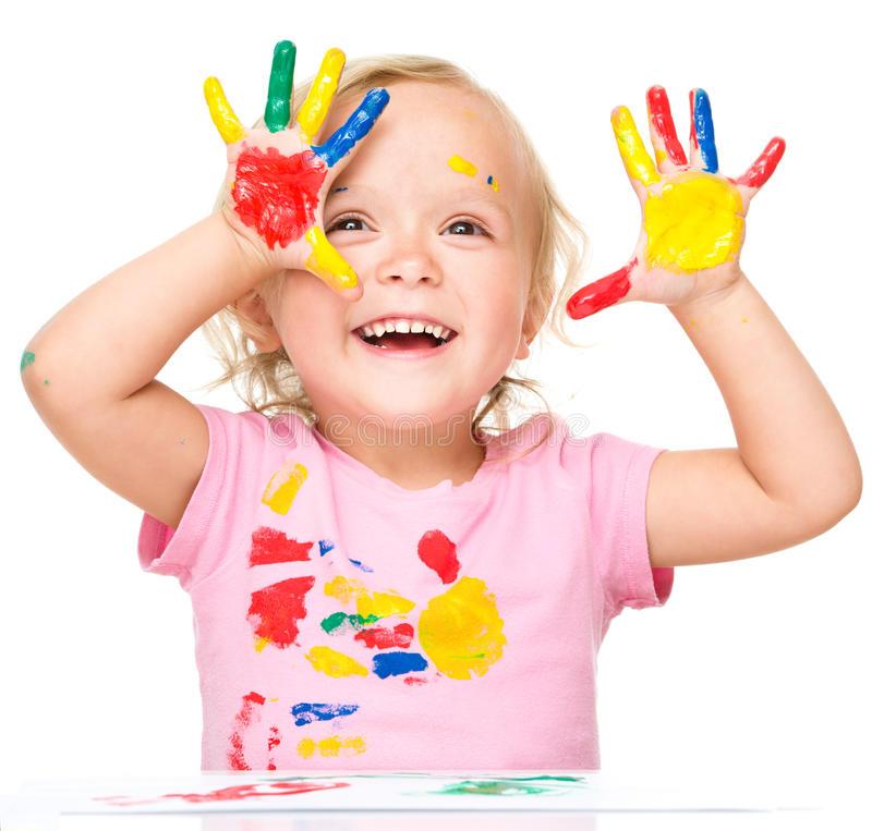 Portrait of a cute little girl playing with paints. Portrait of a cute little girl showing her hands painted in bright colors, isolated over white stock photography