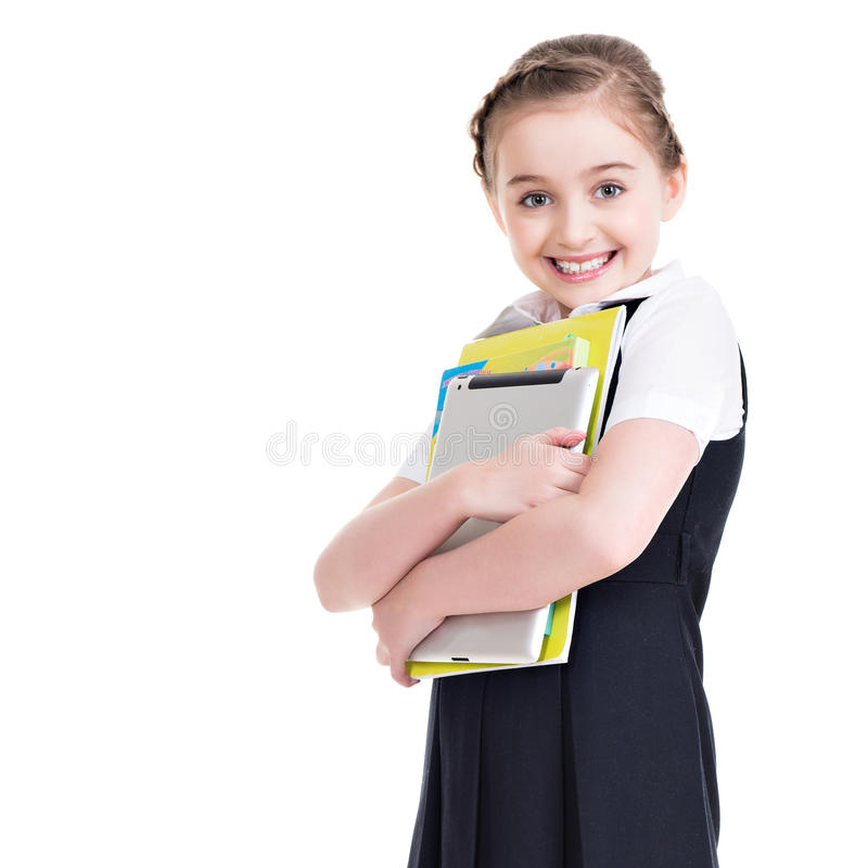 Portrait of a cute little girl standing with tablet. stock photo