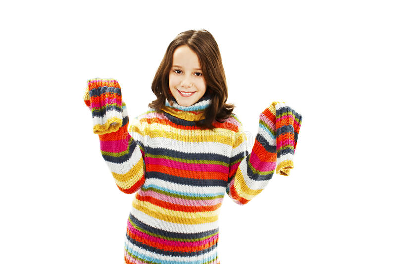 Portrait of a cute little girl in a striped sweater royalty free stock image
