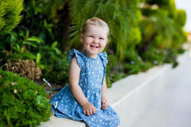 Portrait of cute little girl in summer garden royalty free stock photos