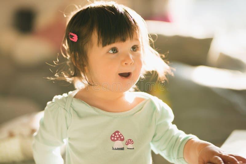 Portrait of cute little girl surprised stock image