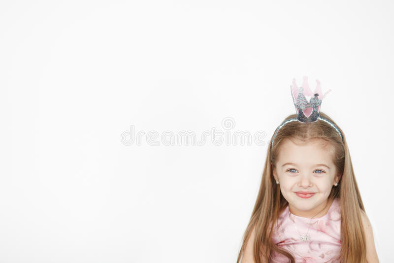 Portrait of cute little girl wearing princess pink dress royalty free stock image