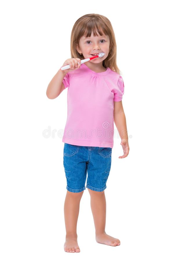 Portrait of cute little girl 3 year old in pink t-shirt brushing her teeth isolated on white background royalty free stock photo