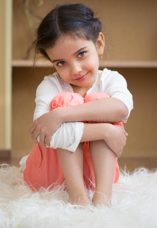 Portrait of cute little hispanic girl stock photography