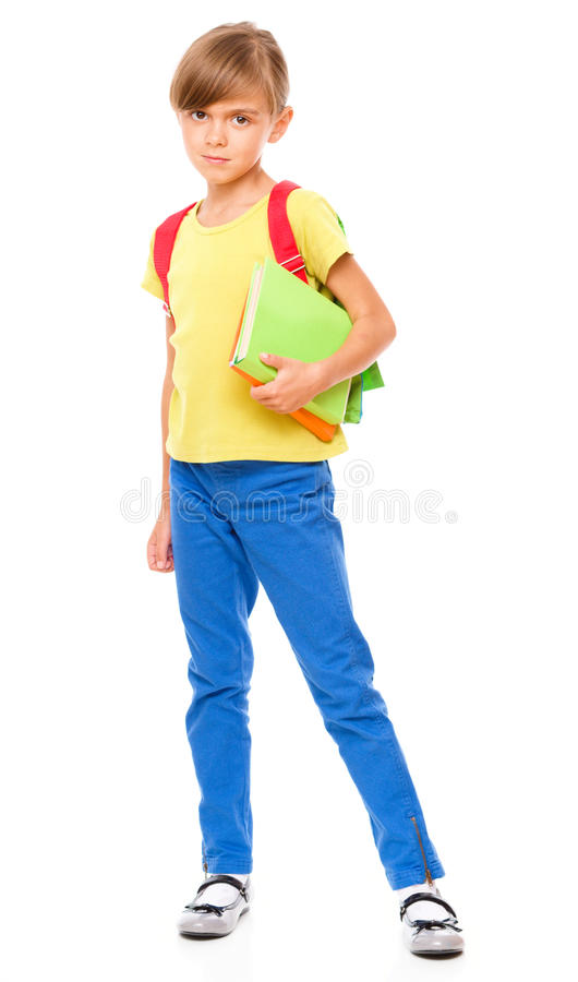 Portrait of a cute little schoolgirl with backpack. Portrait of little schoolgirl with backpack holding a book, isolated over white royalty free stock photos