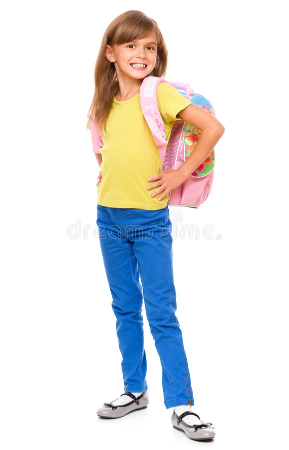 Portrait of a cute little schoolgirl with backpack. Isolated over white royalty free stock photo