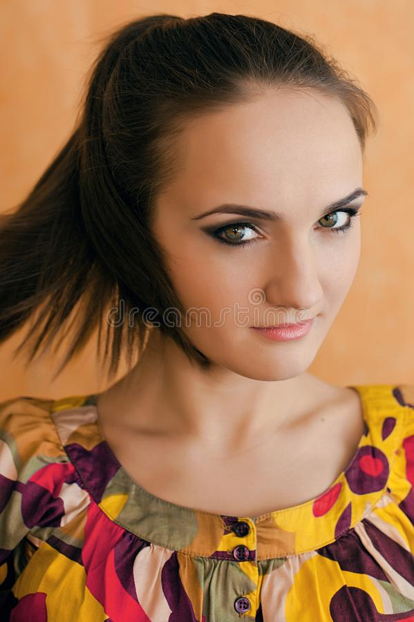 Portrait of cute lovely cheerful young woman in bright shirt on royalty free stock photo