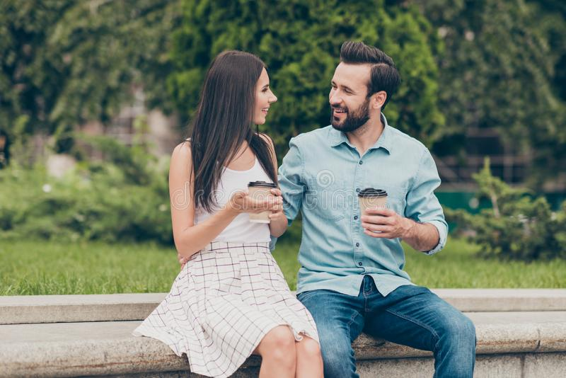 Portrait of cute lovely romantic romance person have dialogue communicate fun conversation tell talk speak say sit bench. Portrait of cute lovely romantic royalty free stock photos