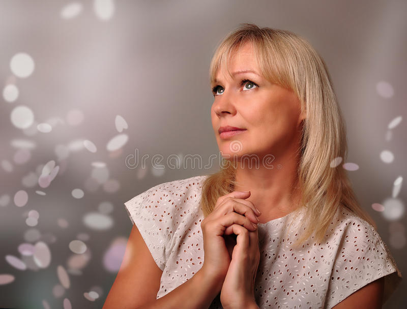 portrait of a cute mature woman dreaming stock photo - image of